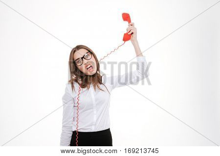 Crazy business woman tangled with phone tube wire isolated on a white background