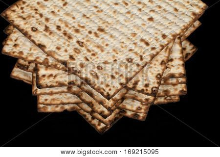 Traditional Jewish matzah on a black background. Close-up