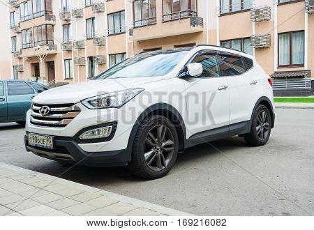 Sochi, Russia - October 11, 2016: New white Hyundai Santa Fe parked on the street near the house.