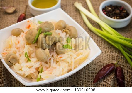 Braised Cabbage With Carrots And Mushrooms In A Bowl. Wooden Background. Top View. Close-up