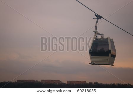 Cableway on mountains background in autumn season
