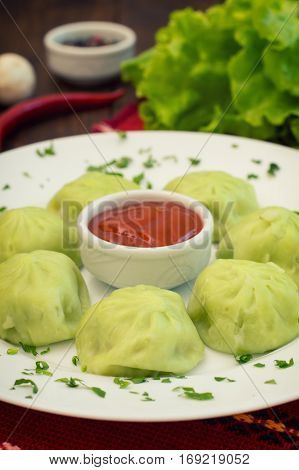 Georgian Dumplings Khinkali Of Spinach Dough With Meat And Tomato Spicy Sauce Satsebeli. Wooden Back
