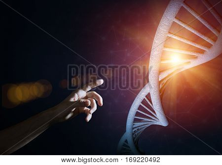 Close of man hand presenting DNA molecule research as concept. Mixed media