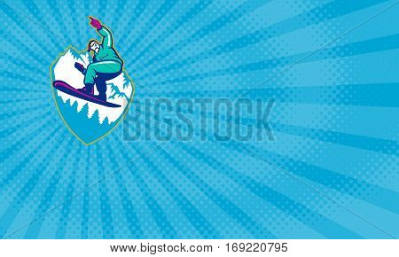 Business card showing Illustration of a snowboarding jumping on snowboard pointing forward set inside crest shield with mountain alps and alpine trees in background.