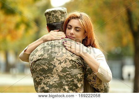 Soldier reunited with wife on a sunny day
