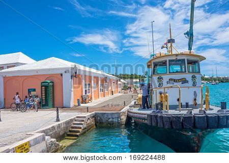 ST.GEORGE'S BERMUDA MAY 27 - Colorful architecture turquoise water with a boat on May 27 2016 in scenic St. George's Bermuda.