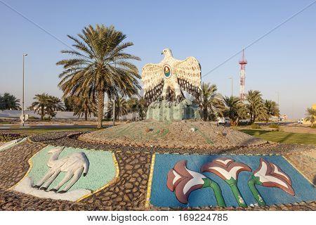 MADINAT ZAYED, UAE - DEC 4, 2016: Falcon monument in a roundabout in the city of Madinat Zayed. Emirate of Abu Dhabi United Arab Emirates