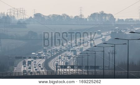 British motorway in a rush hours in a foggy afternoon