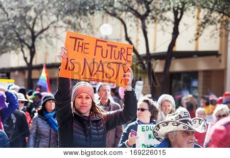 The Future Is Nasty Sign Held By Woman At March