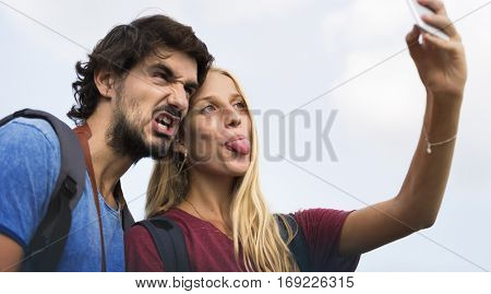 Couple taking a wacky selfie tongue out