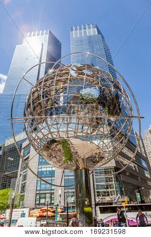 New York USA- May 20 2014. The globe sculpture at the Trump International Hotel and Tower near the 59th Street Columbus Circle Subway Station New York USA.