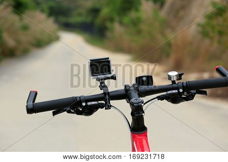 mountain bike with active camera on forest trail