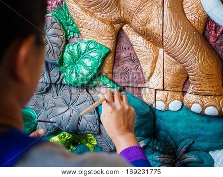 The Hand of artist painting asia elephant