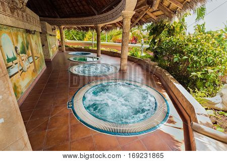 Holguing Province, Playa Pesquero hotel, Cuba, Sep. 4, 2016, inviting amazing view of outdoor spa room with hydro massage working Jacuzzi