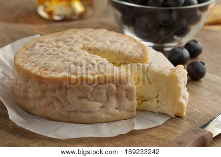 Creamy ripe Epoisses cheese close up