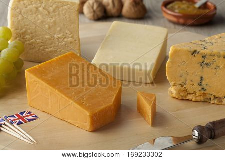 Pieces of traditional english cheese on a cheeseboard