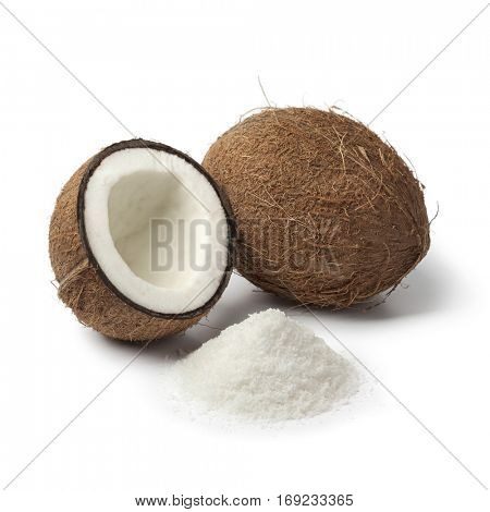 Coconuts with white shredded coconut meat on white background