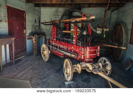 Toronto, Ontario, Canada, Black Creek Pioneer Village park, Oct. 10, 2016, nice amazing view of old vintage, retro, classic fire pump vehicle, trailer in the garage