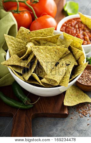Healthy green corn tortilla chips with spinach and flax seeds
