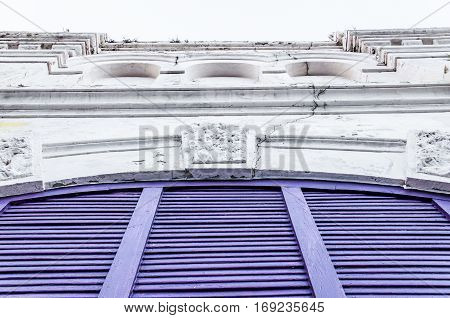 Purple shutter doors and stone architecture closeup