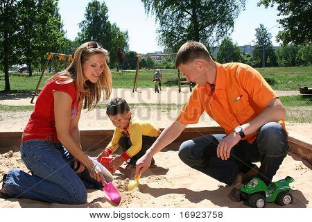 happy family is playing in park