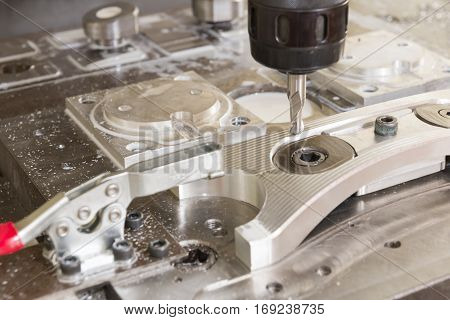 The CNC milling machine cutting the sample part with the ball end-mill and toggle clamping