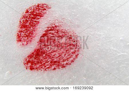 Red broken heart frozen in ice for Valentine's Day