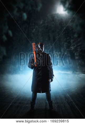 Evil embodiment in hockey mask and leather coat