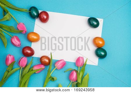Top view of Easte still life with eggs and tulips with copy space