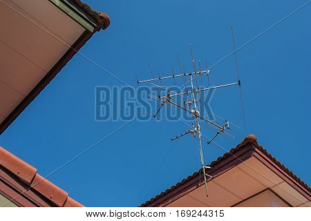 TV antenna with blue sky background at daylight.