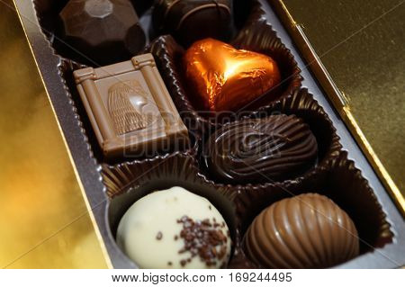Box of fine chocolates of different shapes and colors
