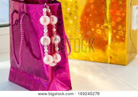 Because  Package With The Sale Of Pink Pearls Hanging