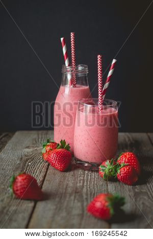 chill and relax time with strawberry smoothie with wood background and copy space