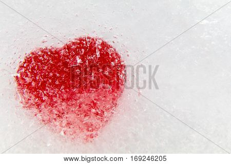 Red heart frozen in ice background and room for copy