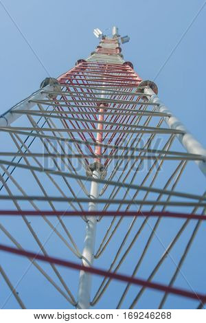 Mobile antenna with blue sky background at daylight