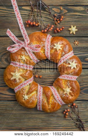 Christmas bread (kalach), traditional Christmas dish in Ukraine over wooden background.