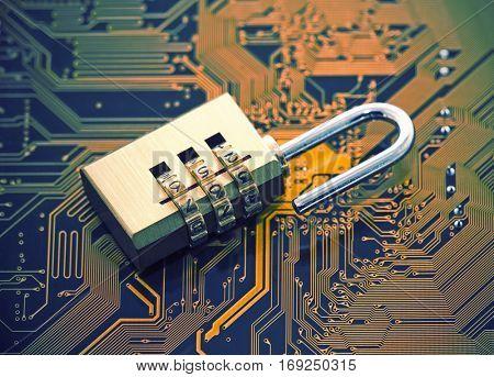 Computer security concept. Padlock on computer circuit board