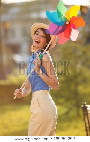 Young happy funny (vintage) dressed woman with colorful weather vanelooking like flower Picture ideal for illustating woman magazines