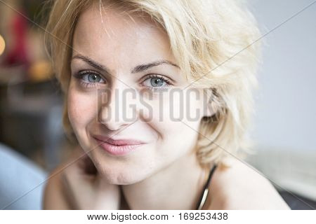 Close-up portrait of confident woman in cafe