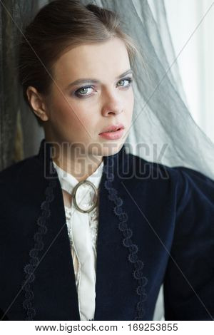 Close-up portrait of sensual young woman in vintage dress in a day light. Professional style and make-up
