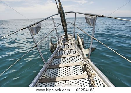 Bow of yacht sailing in sea