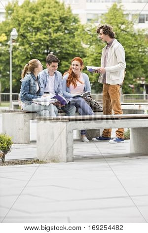 Group of friends studying together at college campus