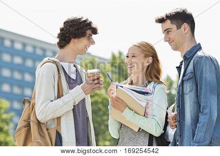 Happy university students conversing at campus