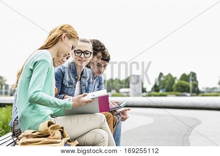 University students studying together at park
