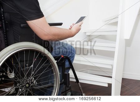 Empty wheelchair and stairs. Disabled accessibility reality