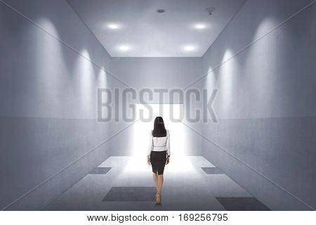Back View Of A Young Asian Business Woman Walking To Opened Door