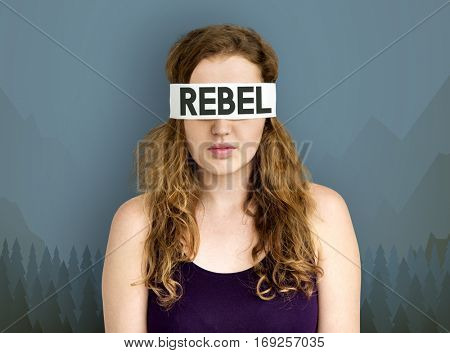 Woman blindfolded with word rebel