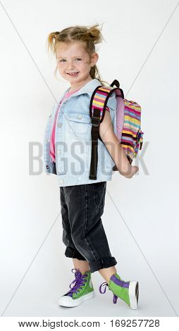 Young little girl wearing backpack portrait