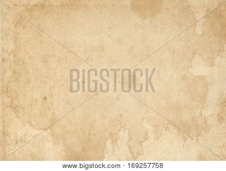 Aged stained paper background. Grunge paper for the design.