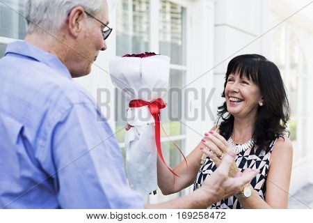 Mature couple woman bouquet of flowers